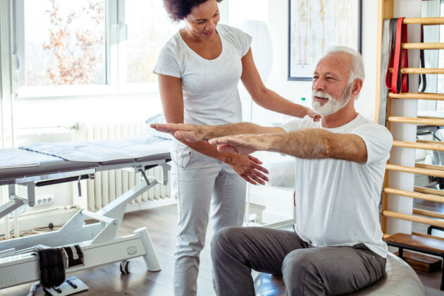 doing physical therapy with older gentleman.